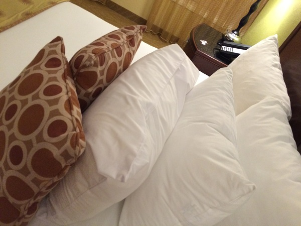 bed full of hotel pillows