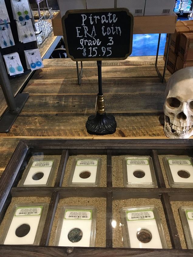 pirate era coins in gift shop branson
